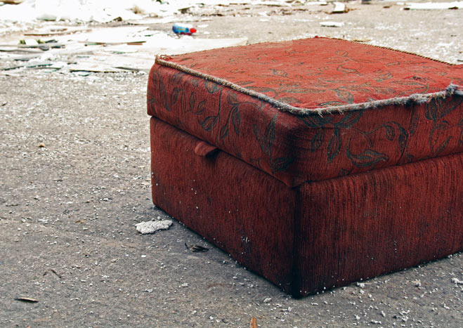 Discarded footstool with lid closed