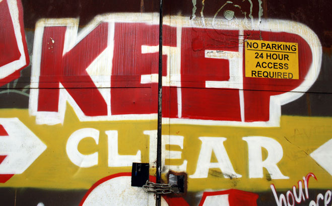 Keep clear spray painted on iron gate